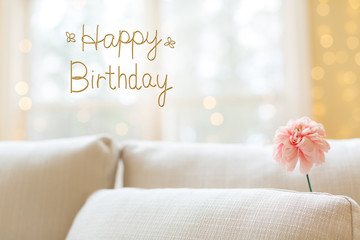 Birthday message with a flower in a bright interior room sofa