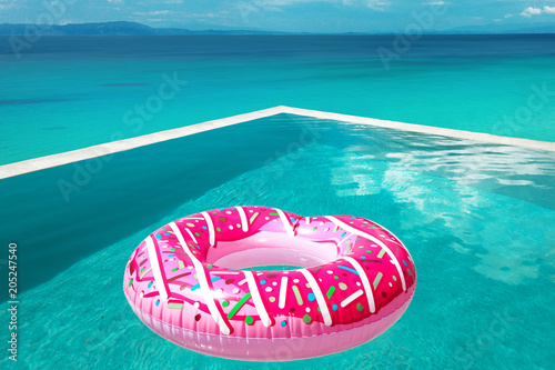 Pink Pool float. Big inflatable donut in infinity swimming ...