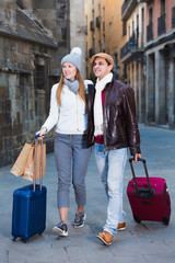 Man and woman with bags in autumn