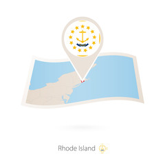 Folded paper map of Rhode Island U.S. State with flag pin of Rhode Island.