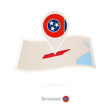 Folded paper map of Tennessee U.S. State with flag pin of Tennessee.