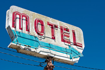 Old, vintage, flaking, motel sign with an arrow