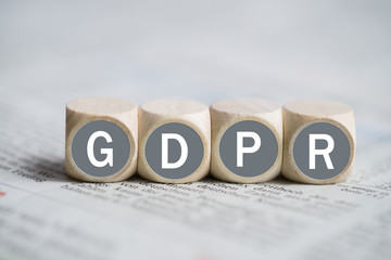 """Cubes with abbreviation """"GDPR"""" on a newspaper"""