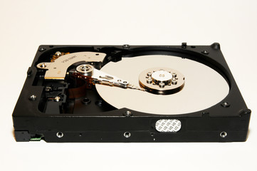 close-up of hard disk opened on wood background