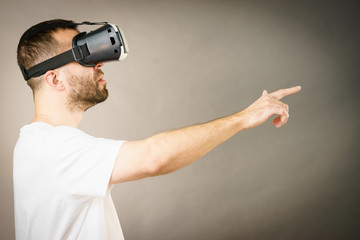 Adult man wearing vr goggles