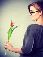 Elegant woman with flower.