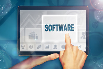 A hand selecting a Software business concept on a computer tablet screen with a colorful background.