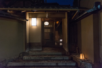 Traditional Japanese house at night, entrance door