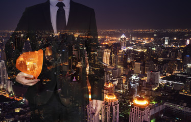 Fotobehang - Double exposure of business people working on city background