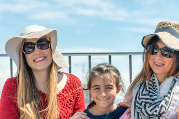 Three generations women on a city rooftop enjoying outdoor life. Tourism and holiday concept
