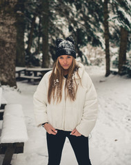 Young woman staying outside in winter