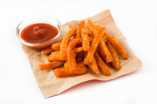 Sweet potato fries and ketchup sauce isolated on white background