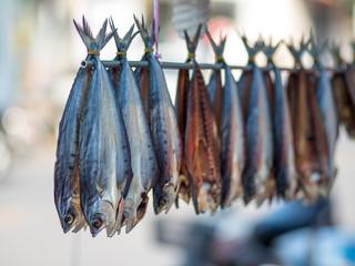 a row of hang fish  in fresh market