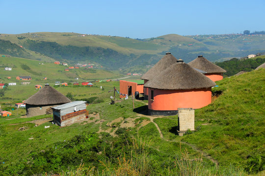 Rondawels, traditional thatched-roofed huts scattered through the grassy hills in a village near Coffee Bay on the Wild Coast in Eastern Cape, South Africa