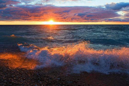 Sunset and Wave Splash on Lake Michigan. Sleeping Bear Dunes, Michigan, USA