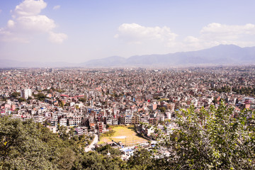 Panorama view over Kathmandu city from Swayambhunath temple complex, Nepal. Himalayas mountains on the background. Image with copy space.