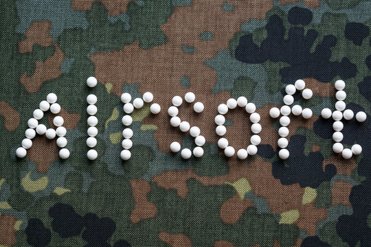 inscription airsoft plastic balls bbs on camouflage fabric