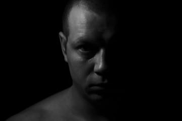 Portrait of the man. Half face man.