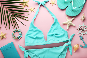 Blue swimsuit with palm leaf and starfishes on pink background