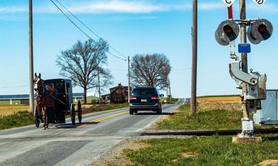 Amish Buggy passing Rail Road Crossing