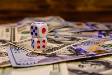 Dice on the one hundred dollar bills. Gamble concept