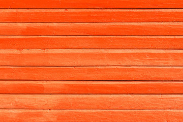 Orange painted wooden background, texture or wall