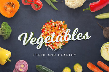 Chopped fresh vegetables and 3D text on black kitchen surface.