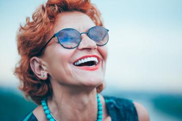 Happy mature woman enjoying life