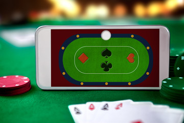 Smartphone with playing cards and chip cards