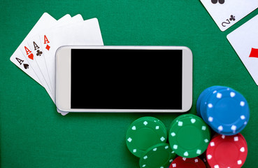 Smartphone with chip cards and playing cards