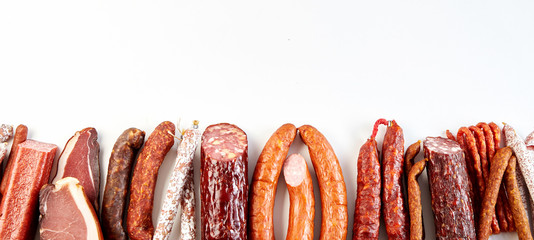 Panorama banner with a diversity of spicy sausages