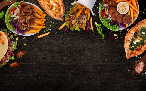 Top down view on traditional turkish meals on black stone table.