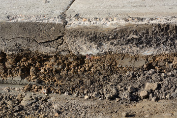 Close up of layers from scraping off of old asphalt in road pavement construction work