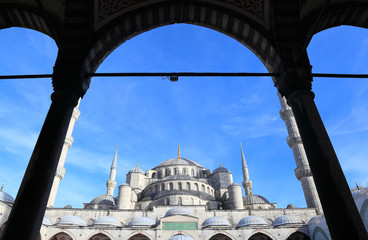 The Blue Mosque (Sultanahmet Mosque) in Istanbul framed by an arch.
