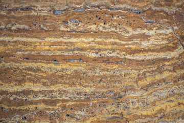 Beautiful Tiger yellow - orange -brown granite thumb vein cut background texture, close up.
