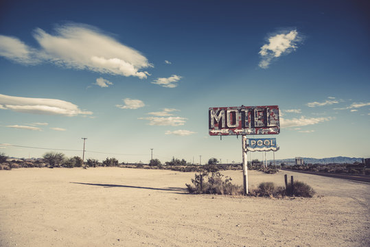 A dilapidated, classic, vintage motel sign in the desert of Arizona