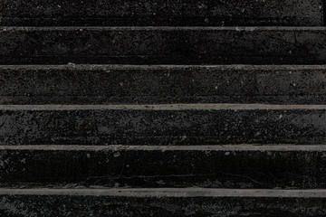 Death. Conceptual high-contrast image of black charred concrete steps