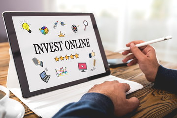 Invest Online Concept on Digital Tablet Screen in Office