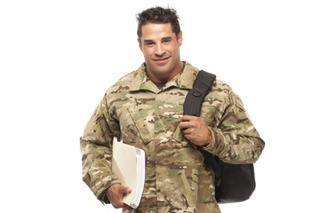 Smiling soldier with bag and books