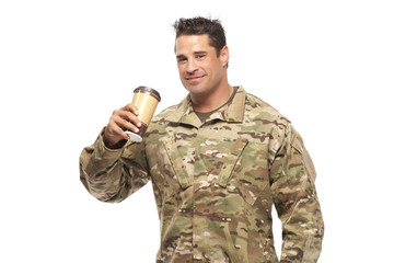 Smiling soldier drinking coffee
