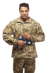 US Soldier holding folded flag