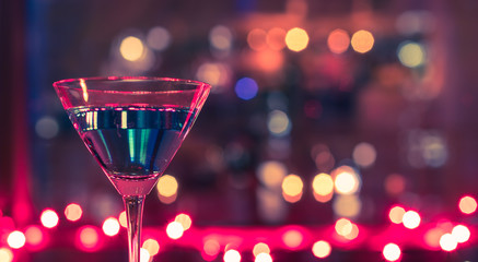 Martini cocktail drink against colorful background.