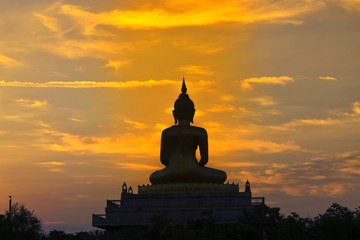 Morning light reflects the Buddha.