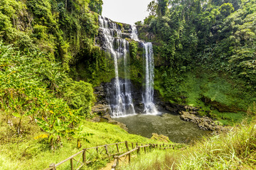 Beautiful view of waterfall landscape. Small waterfall in deep green forest scenery