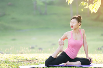 young beautiful asian woman practicing yoga