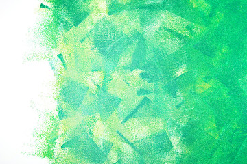 colorful green acrylic paint roller strokes texture on white wall