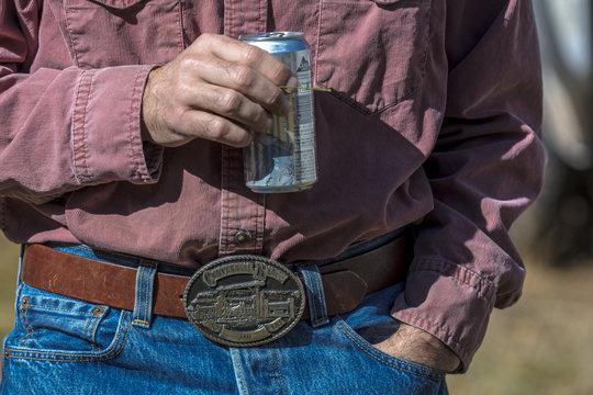 Cowboy drinks beer after ride, Ridgway, Colorado
