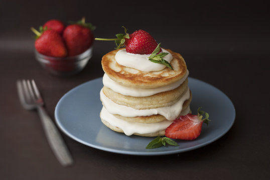 Dessert Pancakes with Cream and Strawbery. Health Breakfast Fruit Berry Vitamine Black Background