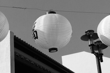 Hanging Lanterns with building and roof top (Black and white)