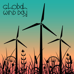 Global Wind Day. Wind turbines against the background of the evening sky and grass
